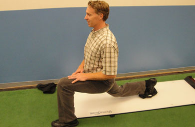 Dr. Morgan demonstrating the Slideboard Reverse Lunge